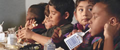 photo of kids eating lunch