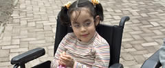 photo of girl in a wheelchair